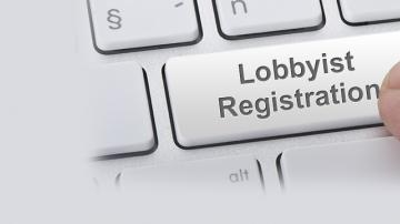 "Computer keyboard with ""Lobbyist Registration"" button being pressed"